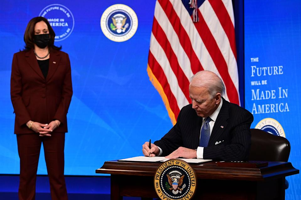 """President Joe Biden with Vice President Kamala Harris signs a """"Made in America"""" Executive Order, to increase the amount of federal spending that goes to US companies (AFP via Getty Images)"""