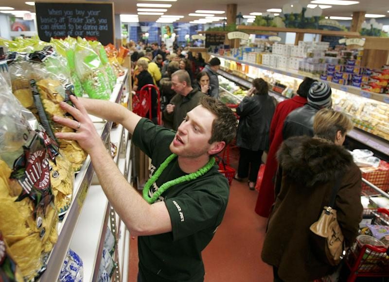 Jason Baglin restocks chips as shoppers line up inside Trader Joe's for the grand opening on 14th Street on March 17, 2006 in New York City. (Photo: Michael Nagle/Getty Images)
