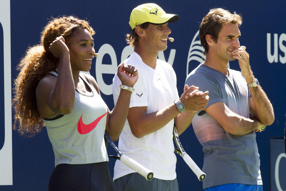 FILE - In this Aug. 24, 2013, file photo, tennis players, from left, Serena Williams, Rafael Nadal and Roger Federer cheer on the competition at the 18th Annual Arthur Ashe Kids' Day, the kick off to the 2013 US Open tennis tournament, on Saturday, in New York. The last time a Grand Slam tennis tournament was played without Serena Williams, Roger Federer and Rafael Nadal was in 1997. The U.S. Open will start next week without any of that trio after Williams, 39, withdrew on Wednesday, joining Federer, 40, and Nadal, 35, on the sideline because of injury. (Photo by Charles Sykes/Invision/AP, File)