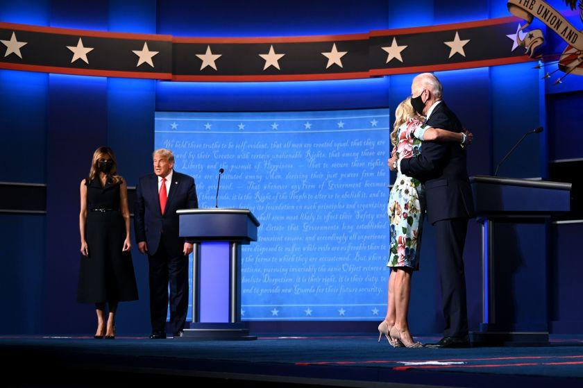 US First Lady Melania Trump (L) stands with US President Donald Trump as Jill Biden (R) hugs husband Democratic Presidential candidate and former US Vice President Joe Biden after the conclusion of the final presidential debate at Belmont University in Nashville, Tennessee, on October 22, 2020. (Photo by Jim WATSON / AFP) (Photo by JIM WATSON/AFP via Getty Images)