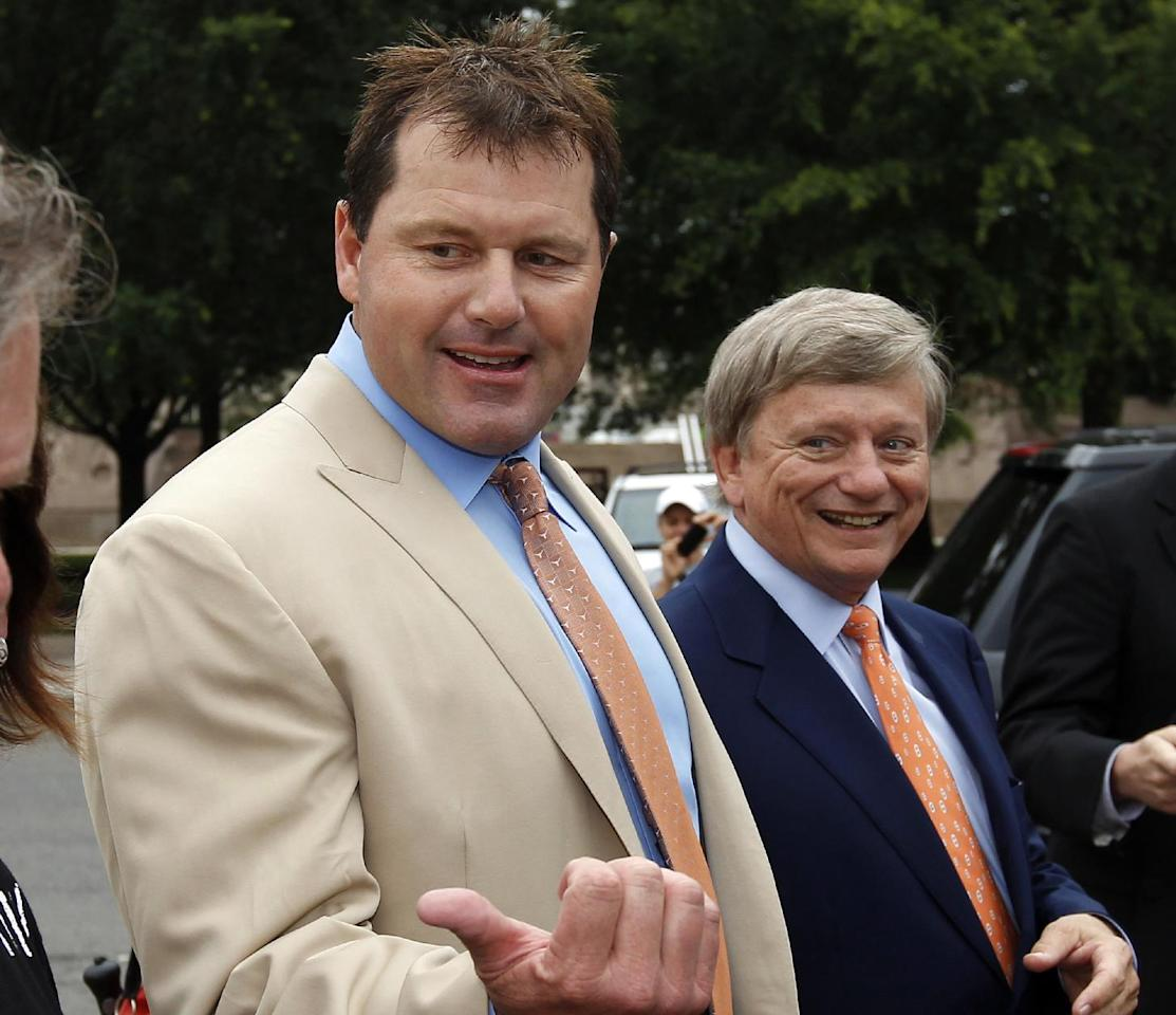 Former Major League Baseball pitcher Roger Clemens, left, with his attorney Rusty Hardin, arrives at federal court Monday, June 18, 2012. Clemens has been acquitted on all charges by a jury that decided he didn't lie to Congress when he denied using performance-enhancing drugs. . (AP Photo/Alex Brandon)