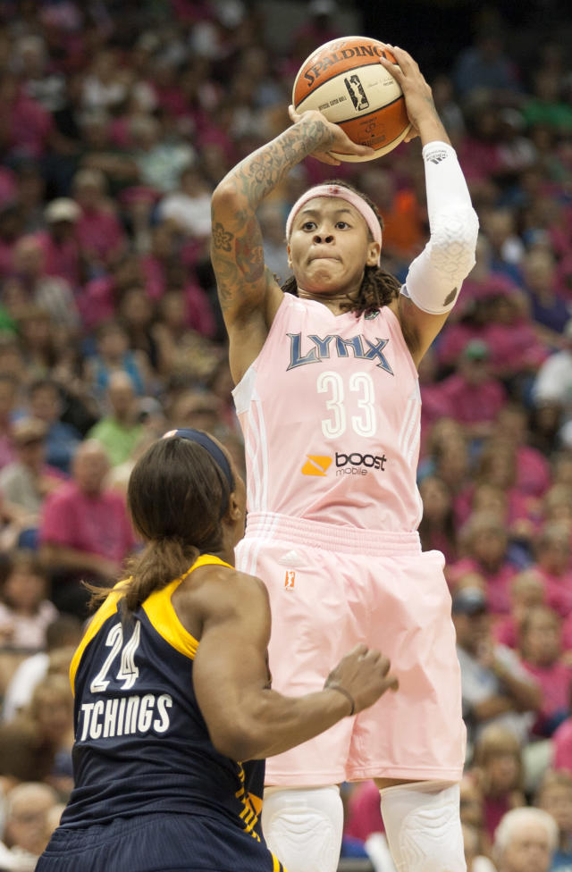 Minnesota Lynx guard Seimone Augustus (33) shoots against Indiana Fever forward Tamika Catchings (24) during the first half of an WNBA basketball game on Saturday, Aug. 24, 2013, in Minneapolis. Augustus had 17 points for the night as Minnesota won 84-77. (AP Photo/Paul Battaglia)