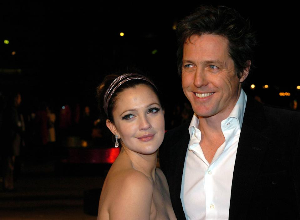 Hugh Grant and Drew Barrymore at the Charity World Premiere of Music and Lyrics at the Odeon Leicester Square in central London.   (Photo by Joel Ryan - PA Images/PA Images via Getty Images)
