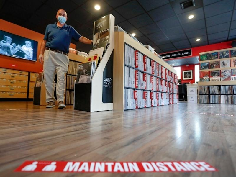 Mark Mawhinney prepares his store to reopen Friday when some of the coronavirus restrictions will be lessened in Pittsburgh and several western Pennsylvania counties.