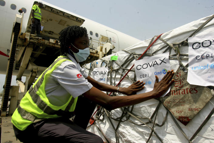 FILE - In this Feb. 25, 2021, file photo, a shipment of COVID-19 vaccines distributed by the COVAX global initiative arrives in Abidjan, Ivory Coast. As many as 60 countries, including some of the poorest, might be stalled at the first shots of their coronavirus vaccinations because nearly all deliveries through the program intended to help them are being blocked until as late as June. (AP Photo/Diomande Ble Blonde, File)
