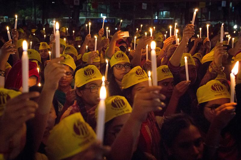 Women from all walks of life hold a candlelight vigil on the Central Shaheed Minar premises just after midnight.