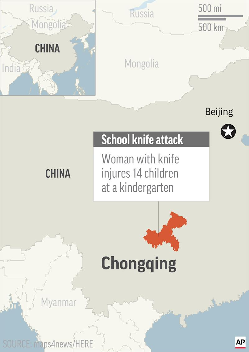 Woman with knife injures 14 children at western China on