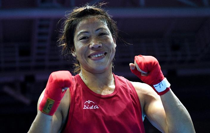 Mary Kom reacts after being declared the winner of the Asian Games women's flyweight (48-51kg) boxing final in Incheon on October 1, 2014 (AFP Photo/Indranil Mukherjee)