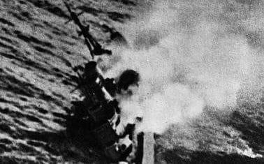 The British cruiser HMS <Exeter> goes down after heavy Japanese bombardment during the Battle of the Java Sea - Corbis