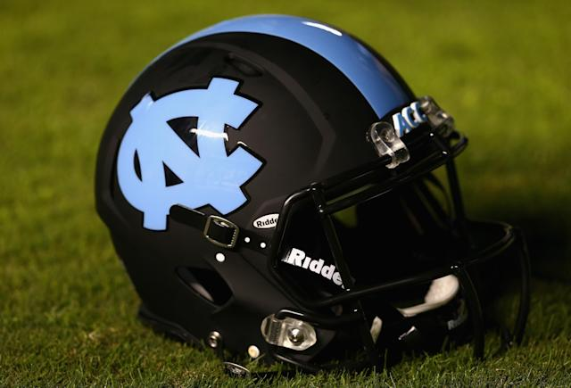 CHAPEL HILL, NC - OCTOBER 17: A helmet of the North Carolina Tar Heels sits on the field before their game against the Miami Hurricanes at Kenan Stadium on October 17, 2013 in Chapel Hill, North Carolina. (Photo by Streeter Lecka/Getty Images)