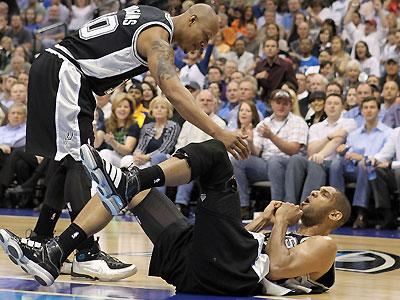 Tim Duncan, getting assistance from Keith Bogans, has literally picked his game up since struggling in March