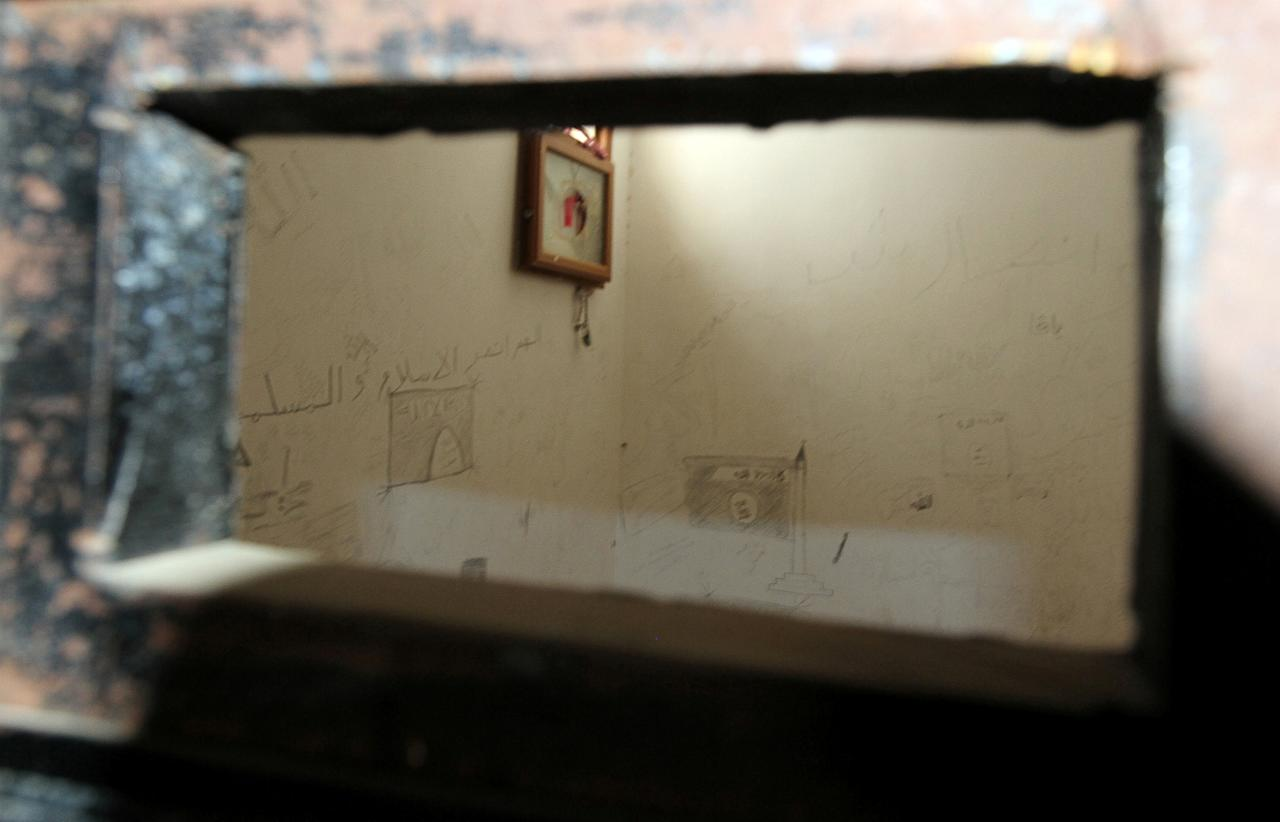 Drawings including one of an Islamic States flags are seen on a wall inside a jail used by Islamic State fighters after it was captured by Libyan forces allied with the U.N.-backed government, in Sirte, Libya August 27, 2016. REUTERS/Hani Amara
