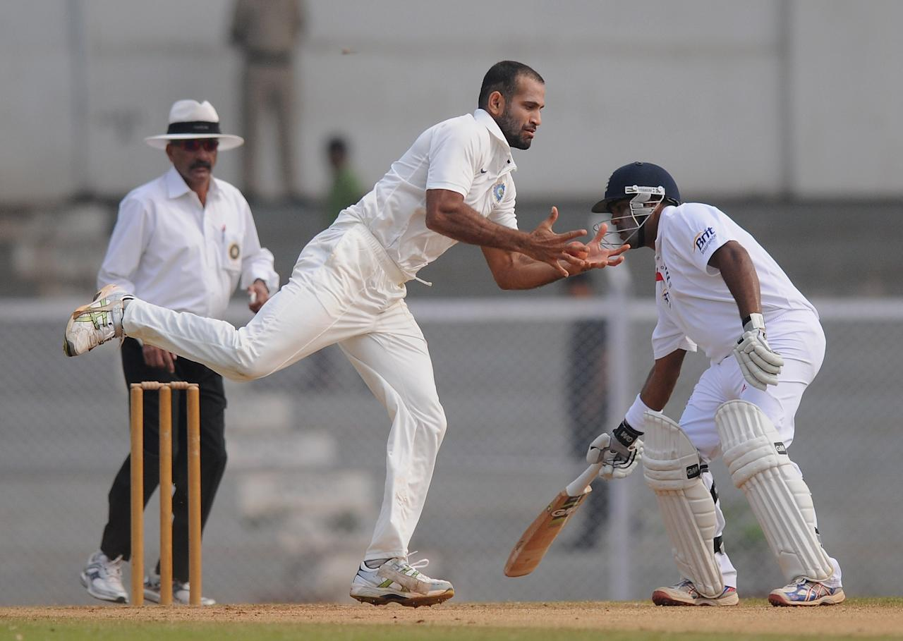 MUMBAI, INDIA - NOVEMBER 01:   Irfan Pathan (C) of India 'A' tries to stop a ball of his own bowling during the final day of the first practice match between England and India 'A' at the CCI (Cricket Club of India) ground, on November 1, 2012 in Mumbai, India.  (Photo by Pal Pillai/Getty Images)