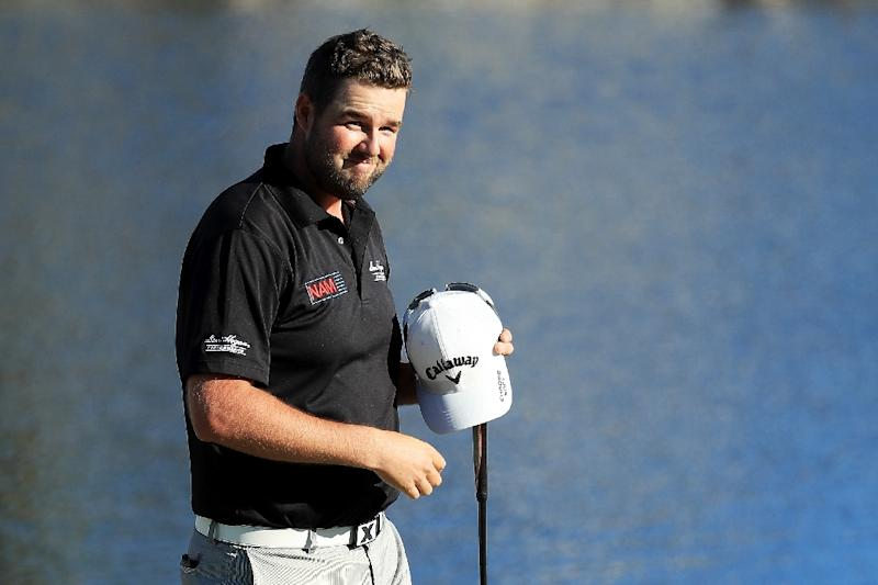 Marc Leishman of Australia celebrates on the 18th green after finishing 11 under to win during the final round of the Arnold Palmer Invitational on March 19, 2017 in Orlando, Florida