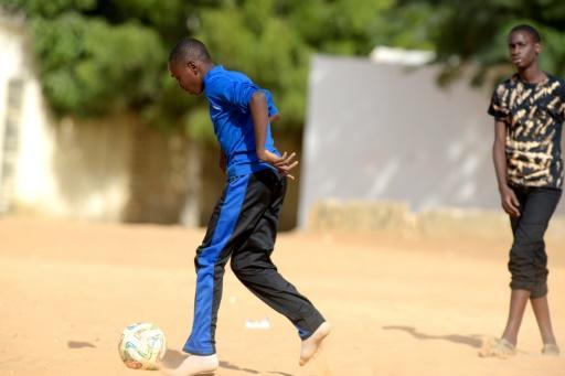 """Des enfants jouent au football le 7 décembre 2015 à Dakar An International Conference is taking place for two days with the theme """"the young football players protection in Africa"""", organised by the Foot Solidaire Association (Solidarity Football) founded by former professional football players and different partners like the Senegalese Football Federation and UNESCO"""