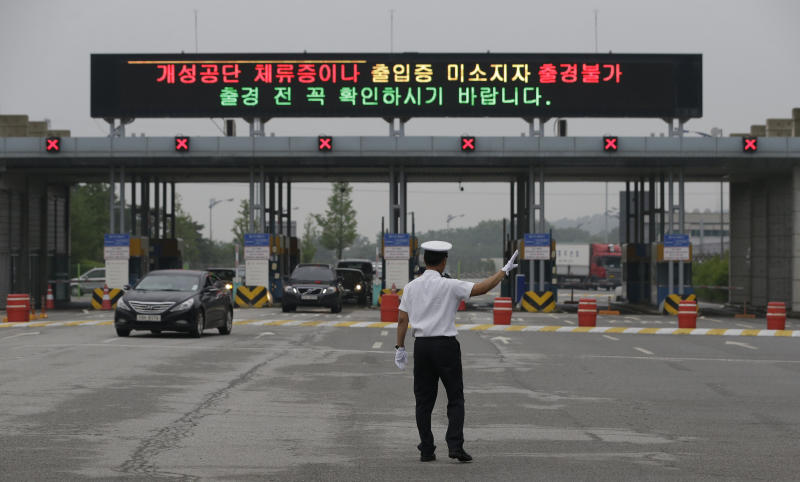 Vehicles carrying South Korean workers, and company owners returning from the stalled South Korea and North Korea's joint Kaesong Industrial Complex, arrive at the customs, immigration and quarantine office near the border village of Panmunjom, that has separated the two Koreas since the Korean War, in Paju, north of Seoul, South Korea, Wednesday, July 10, 2013. Government officials from North and South Korea met Wednesday in a North Korean border town to discuss how to restart a factory complex they ran until it was shut down in April. Representatives of South Korean factories at Kaesong also went to the complex Wednesday to inspect factory equipment that had been left idle during the shutdown, during the peninsula's rainy season. (AP Photo/Lee Jin-man)