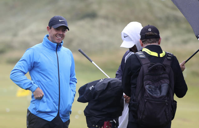 Northern Ireland's Rory McIlroy smiles as he talks to his team on the practice range ahead of the start of the British Open golf championships at Royal Portrush in Northern Ireland, Wednesday, July 17, 2019. The British Open starts Thursday. (AP Photo/Jon Super)
