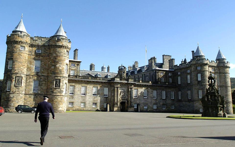 A security guard outside the Palace of Holyroodhouse