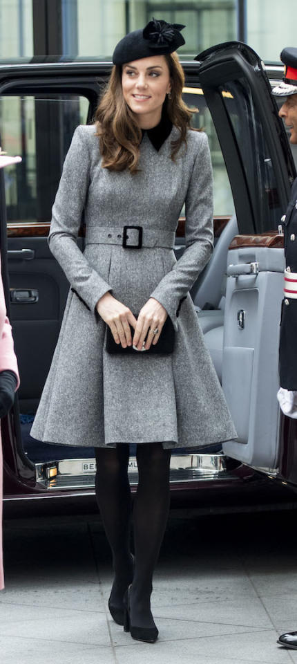 <p>For a visit to King's College to officially open Bush House alongside the Queen, the Duchess of Cambridge dressed in a chic grey Catherine Walker coat dress. She finished the ensemble with her favourite Mulberry clutch along with a Lock & Co hat. <em>[Photo: Getty]</em> </p>