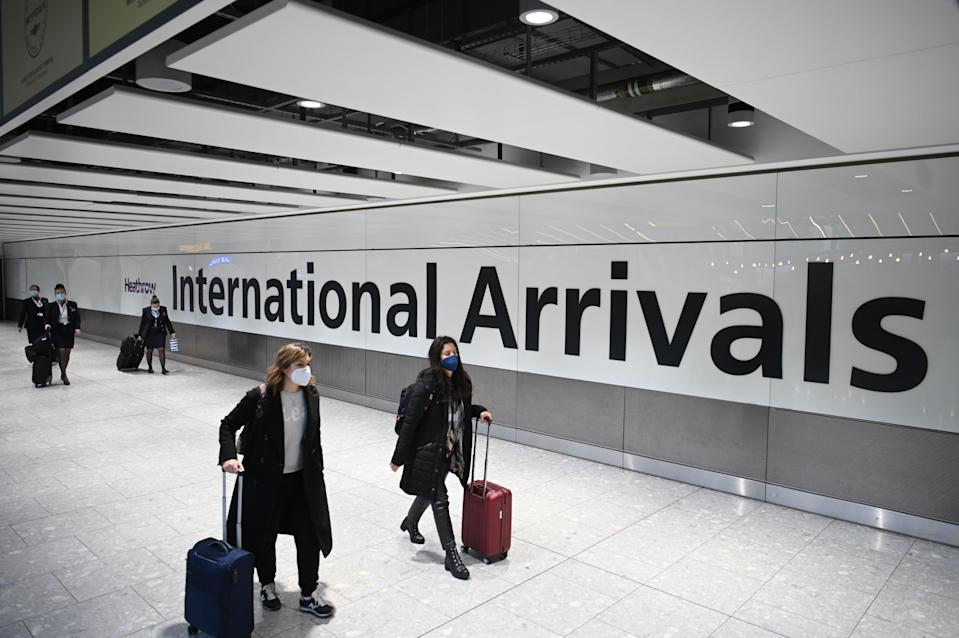 The government has been criticised for waiting nearly a year to introduce strict quarantine measures for new arrivals to the UKAFP via Getty Images