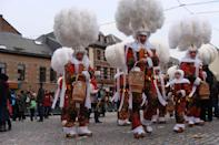 """<p><strong>When</strong>: Feb. 23-25</p> <p>This southern Belgian town has an approach to Mardi Gras dating back to the 14th century that gets a bit peculiar. Known as the <a href=""""https://www.carnivaland.net/binche-carnival/"""" class=""""link rapid-noclick-resp"""" rel=""""nofollow noopener"""" target=""""_blank"""" data-ylk=""""slk:Carnival of Binche"""">Carnival of Binche</a>, the main characters of this pre-Lenten celebration are the Gilles, a clown-looking, waxy-masked bunch of males who are seen on a day known as Shrove Tuesday wearing tunics, trousers, and clogs. These guys parade around on the afternoon of that day and give out oranges to onlookers. Along with having some precarnival festivities six weeks before the actual event, including marching and musical performances, the Carnival of Binche welcomes other noteworthy costumed groups, known as societies such as the Arlequins and Pierrots.</p>"""