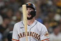 San Francisco Giants' Kris Bryant adjusts his bat while batting during the sixth inning of a baseball game against the San Diego Padres, Wednesday, Sept. 22, 2021, in San Diego. (AP Photo/Gregory Bull)