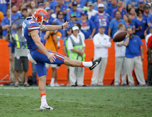 FILE - In this Sept. 26, 2015, file photo, Florida punter Johnny Townsend kicks against Tennessee during the second half of an NCAA college football game, in Gainesville, Fla. Florida kicker Eddy Pineiro and punter Johnny Townsend are looking to become the first specialists drafted from the same team in the same year since 1985. (AP Photo/John Raoux, File)
