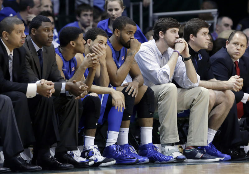 Duke players and staff watch in the closing seconds of an NCAA college basketball game against Miami in Coral Gables, Fla., Wednesday, Jan. 23, 2013. Miami won 90-63. (AP Photo/Alan Diaz)
