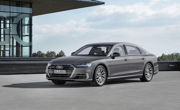 """<p>The fully redesigned <a href=""""https://www.caranddriver.com/audi/a8"""" rel=""""nofollow noopener"""" target=""""_blank"""" data-ylk=""""slk:2019 A8"""" class=""""link rapid-noclick-resp"""">2019 A8</a> features Audi's new <a href=""""https://www.caranddriver.com/news/a15341893/2018-audi-a8-to-feature-48-volt-hybrid-system/"""" rel=""""nofollow noopener"""" target=""""_blank"""" data-ylk=""""slk:Mild Hybrid Electric Vehicle (MHEV) system"""" class=""""link rapid-noclick-resp"""">Mild Hybrid Electric Vehicle (MHEV) system</a>, which is exactly what it sounds like: a mild-hybrid setup! It consists of a motor/generator connected to the engine's crankshaft via the accessory drive belt and a 48-volt electrical system. The motor is used to restart the car after the engine shuts down to save fuel at stoplights and in traffic, as well as to deliver some torque to the engine's crankshaft at low speeds.<br></p>"""