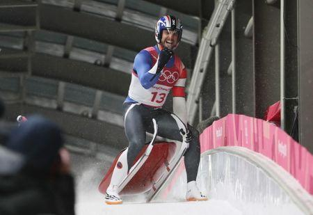 Feb 11, 2018; Pyeongchang, South Korea; Chris Mazdzer (USA) celebrates after the fourth run of the men's single luge in the Pyeongchang 2018 Olympic Winter Games at Olympic Sliding Centre. Eric Seals-USA TODAY Sports