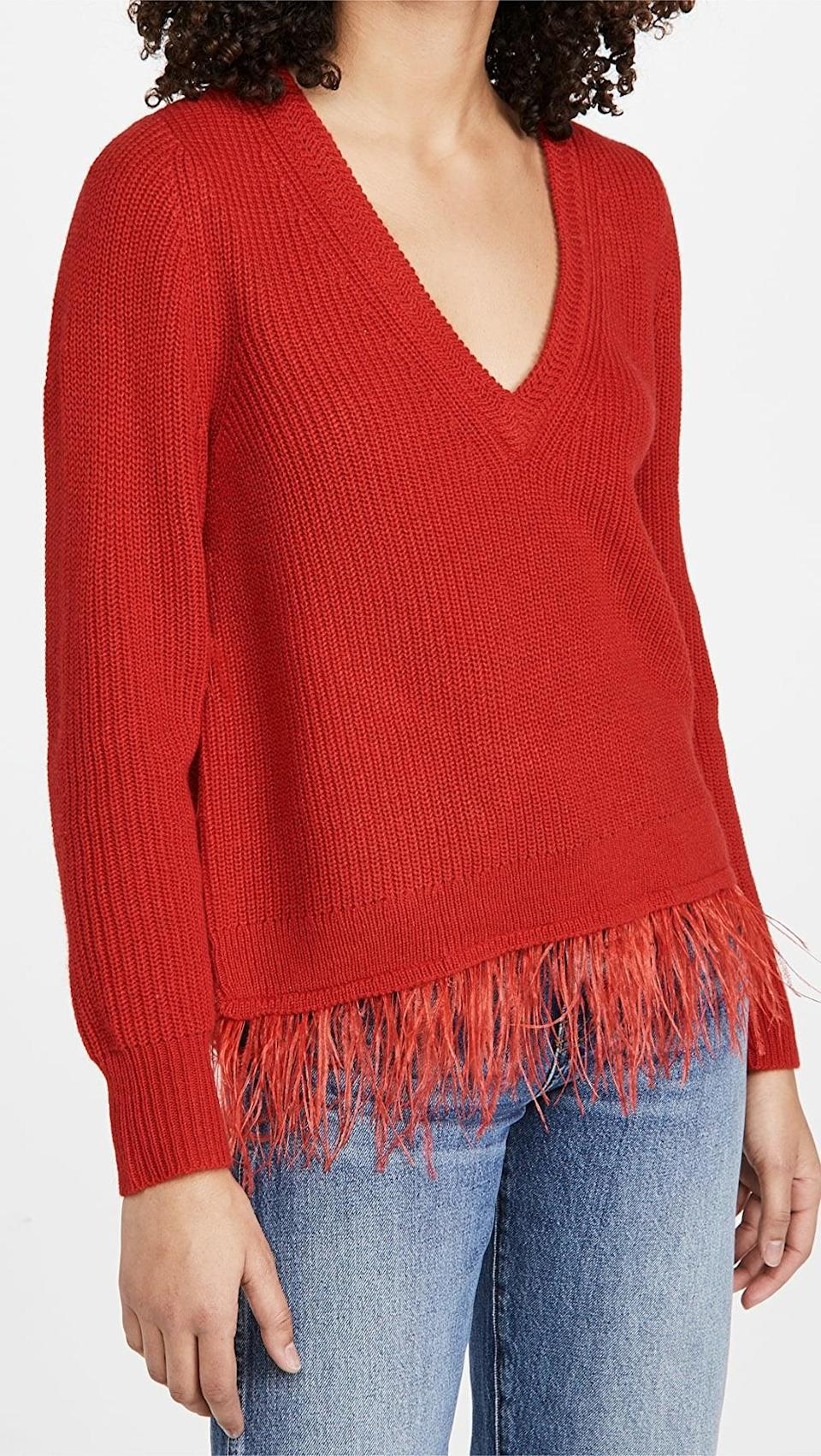 <p>If you're looking for a red sweater, this <span>Saylor Juneau Sweater</span> ($231) adds a little something extra.</p>