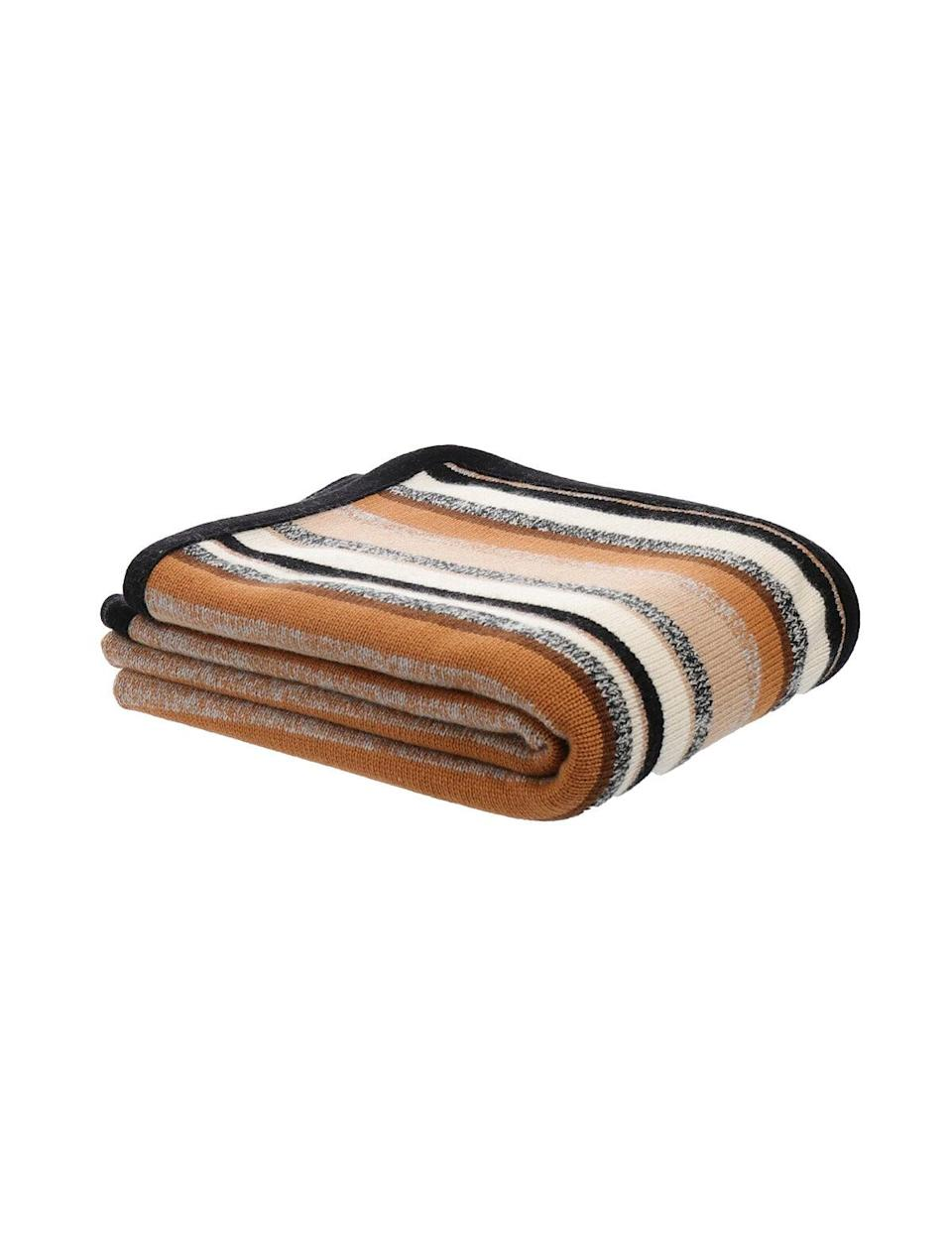 """<p><span>Scaglione Cashmere Blanket</span> ($885)</p> <p>""""This year, since we can't really give people hugs, I'm giving one very special person on my list a cashmere blanket from Scaglione. I have a scarf, hat and sweater in this colorway so maybe it will be like getting a hug from me! I'm into giving the gift of hygge!"""" - NR </p>"""