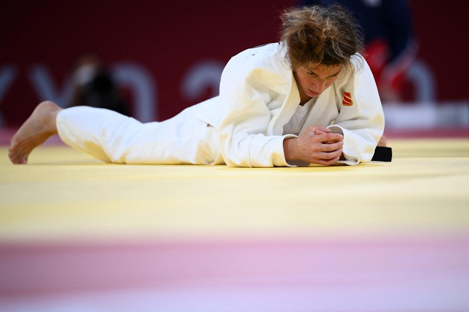 <p>Georgia's Eteri Liparteliani reacts after losing to Japan's Tsukasa Yoshida in the judo women's -57kg bronze medal A bout during the Tokyo 2020 Olympic Games at the Nippon Budokan in Tokyo on July 26, 2021. (Photo by Franck FIFE / AFP) (Photo by FRANCK FIFE/AFP via Getty Images)</p>