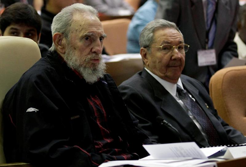 Handout picture released by cubadebate.cu website shows Cuban leader and former president Fidel Castro (L) sitting next to his brother and current president, Raul, in Havana on February 24, 2013