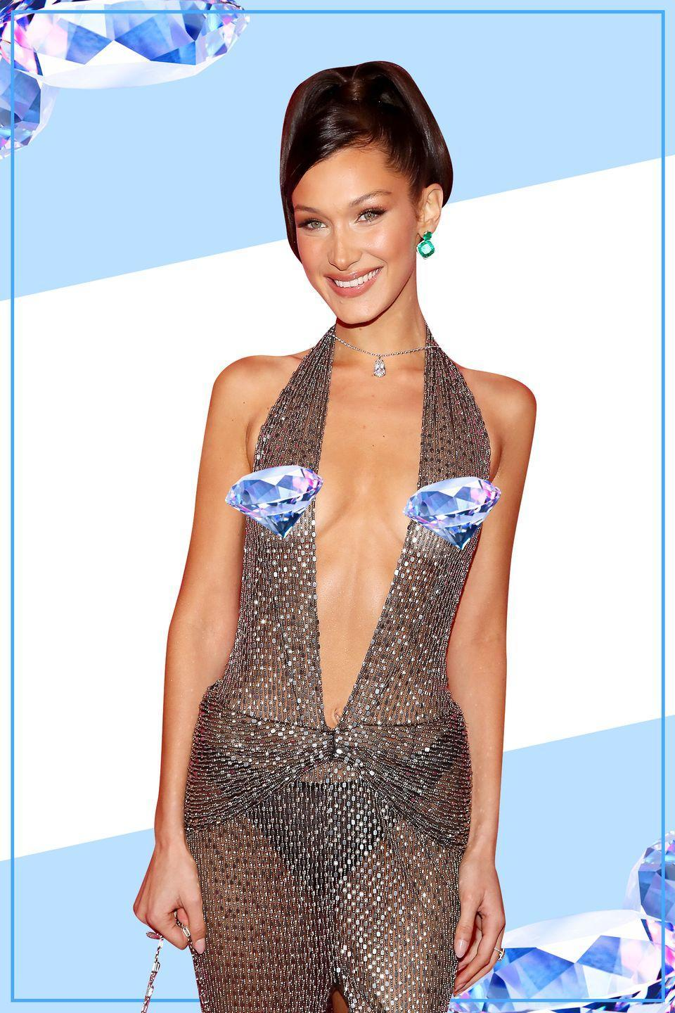 <p>After showing off her entire body at the Victoria's Secret fashion show, Bella slipped into something a little more... revealing. She rocked this ultra sexy see-through dress, flaunting the hottest accessory of the night: her nips. </p>