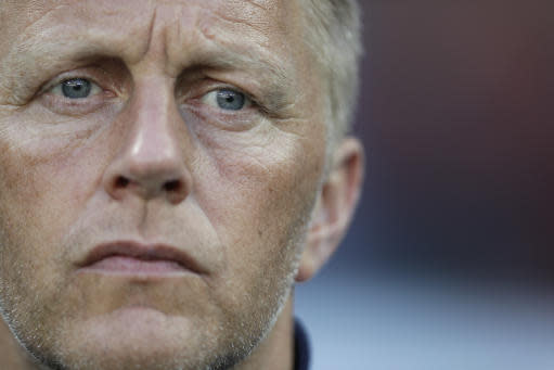 Iceland coach Heimar Hallgrimsson waits for the start of the group D match between Nigeria and Iceland at the 2018 soccer World Cup in the Volgograd Arena in Volgograd, Russia, Friday, June 22, 2018. (AP Photo/Andrew Medichini)