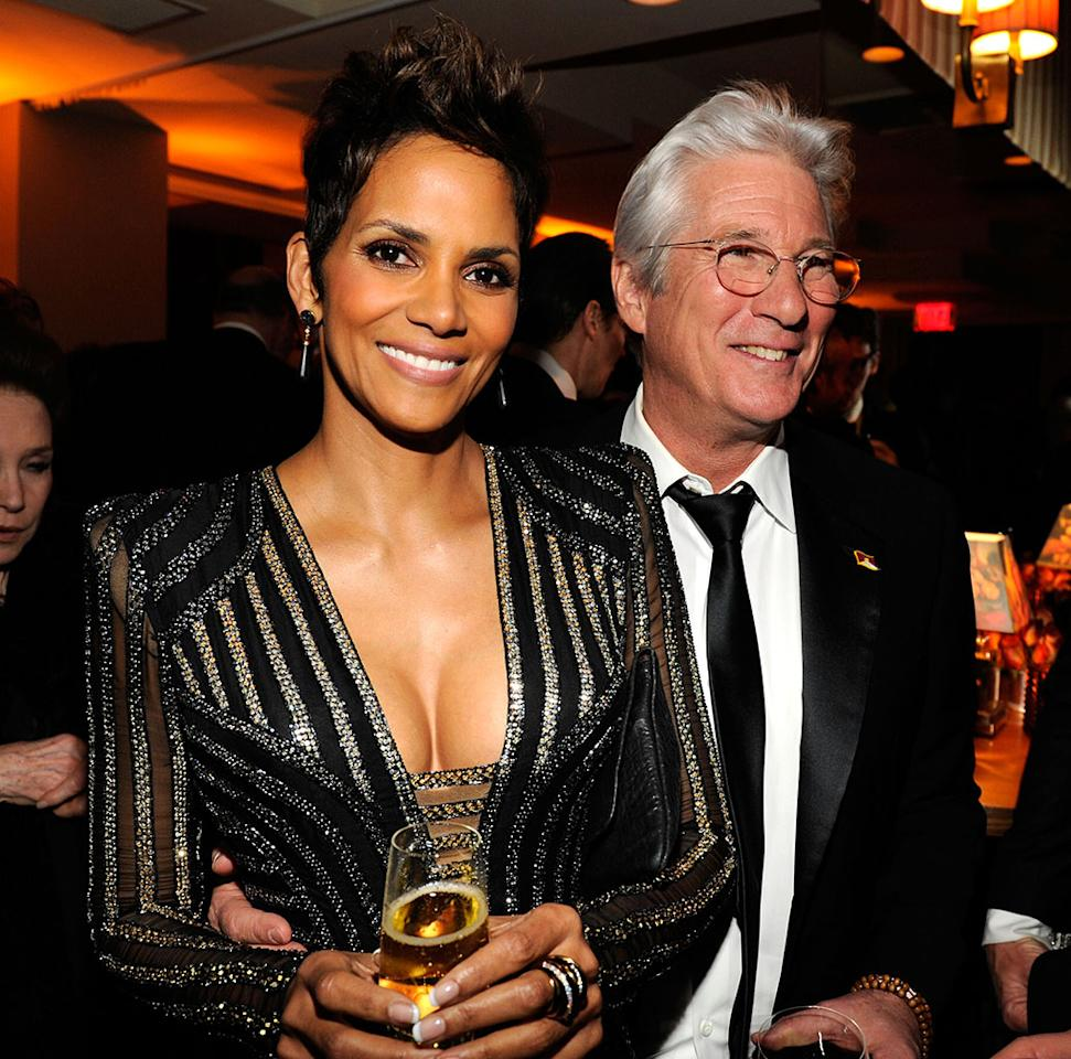Halle Berry and Richard Gere attend the 2013 Vanity Fair Oscar Party hosted by Graydon Carter at Sunset Tower on February 24, 2013 in West Hollywood, California.