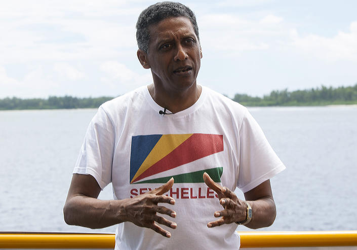 "Seychelles President Danny Faure speaks during an interview with the Associated Press, on the island of Desroches, Seychelles on Sunday April 14, 2019. In a striking speech delivered from deep below the ocean's surface, the Seychelles president on Sunday made a global plea for stronger protection of the ""beating blue heart of our planet."" President Danny Faure's call for action, the first-ever live speech from an underwater submersible, came from one of the many island nations threatened by global warming.(AP Photo/Steve Barker)"