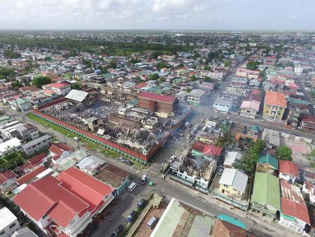 The remains of the Camp Street Prison, after it was destroyed by a fire during a riot, are seen in Georgetown, Guyana, in this July 10, 2017 handout photo taken with a drone. Guyana's Department of Public Information/Handout via REUTERS
