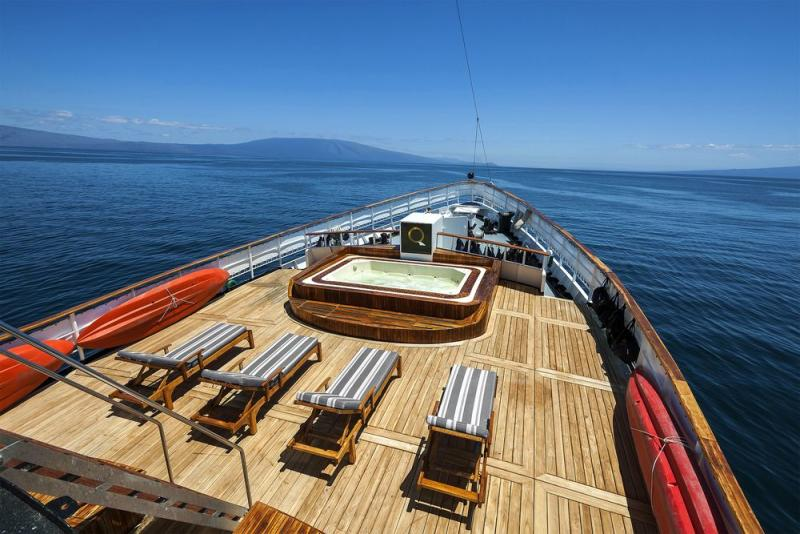 Quasar Expeditions' M/V Evolution yacht sundeck with hot tub.