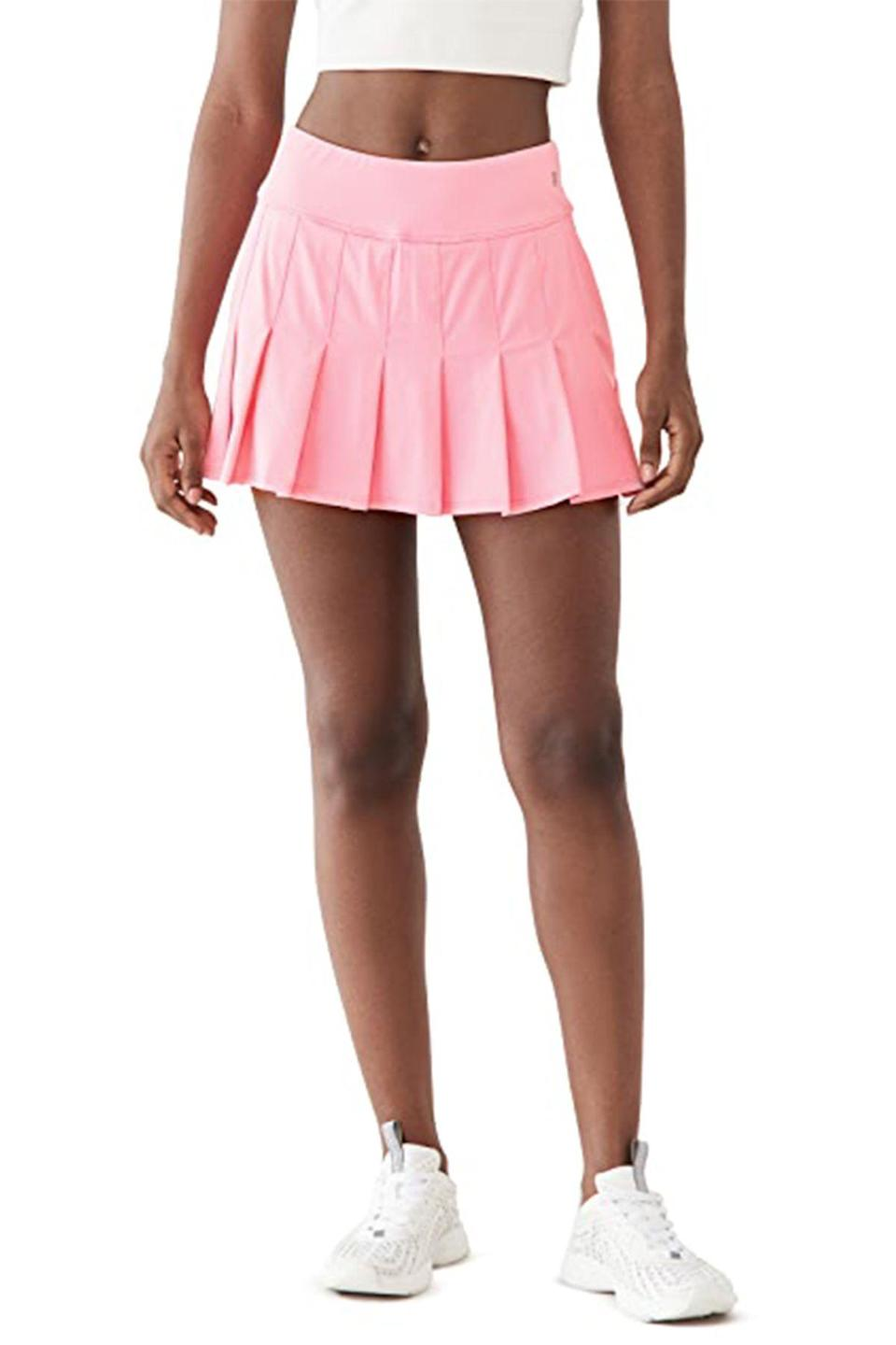 """<p><strong>EleVen by Venus Williams</strong></p><p>shopbop.com</p><p><strong>$79.00</strong></p><p><a href=""""https://go.redirectingat.com?id=74968X1596630&url=https%3A%2F%2Fwww.shopbop.com%2Fflutter-tennis-skirt-eleven-by%2Fvp%2Fv%3D1%2F1570950529.htm&sref=https%3A%2F%2Fwww.townandcountrymag.com%2Fstyle%2Ffashion-trends%2Fg36717600%2Fbest-tennis-skirts%2F"""" rel=""""nofollow noopener"""" target=""""_blank"""" data-ylk=""""slk:Shop Now"""" class=""""link rapid-noclick-resp"""">Shop Now</a></p><p>Tennis champion—and budding fashion mogul—Venus Williams designs every single piece in her EleVen clothing line, so a flawless marriage of form and function is guaranteed.</p>"""