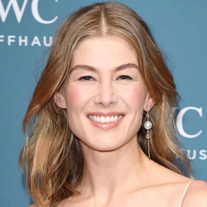 """""""This is what we would call a dimensional blonde. It has a few different tones of blonde that play off each other, creating a natural 'born with it' blonde that makes her skin glow,"""" says Vidov of Rosamund Pike's take on the same color. You might be thinking: <em>That's dirty blonde, ma'am</em>. But the slight grayish tones give this color a modern update."""