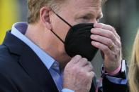 Commissioner Roger Goodell adjusts his mask before the NFL Super Bowl 55 football game between the Kansas City Chiefs and Tampa Bay Buccaneers, Sunday, Feb. 7, 2021, in Tampa, Fla. (AP Photo/David J. Phillip)