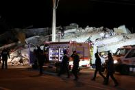 Rescue workers search on a collapsed building after an earthquake in Elazig