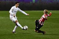 Real Madrid's Lucas Vazquez, left, vies for the ball with Athletic Bilbao's Iker Muniain during Spanish Super Cup semi final soccer match between Real Madrid and Athletic Bilbao at La Rosaleda stadium in Malaga, Spain, Thursday, Jan. 14, 2021. (AP Photo/Jose Breton)