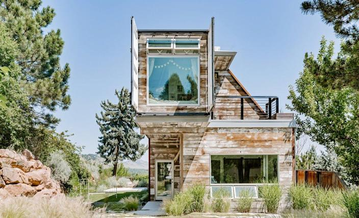 Exterior shot of a gorgeous upcycled shipping container home outside Boulder, Colorado.
