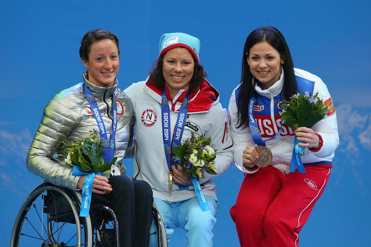 SOCHI, RUSSIA - MARCH 13: Silver medalist Tatyana McFadden of the United States, gold medalist Mariann Marthisen of Norway and bronze medalist Marta Zaynullina of Russia pose on the podium during the medal ceremony for the women's 1km sprint, sitting cross-country during day six of Sochi 2014 Paralympic Winter Games at Rosa Khutor Alpine Center on March 13,2014 in Sochi, Russia. (Photo by Mark Kolbe/Getty Images)