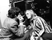 <p>Photographer Linda Eastman talks to Paul McCartney at a 1967 press event for the Beatles album, <em>Sergeant Pepper's Lonely Hearts Club Band</em>.</p>