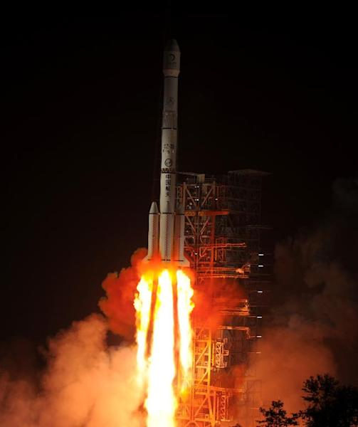 The Chang'e-3 rocket carrying the Jade Rabbit rover blasts off around 1:30 am (Sunday 1730 GMT) into the dark sky, from the Xichang Satellite Launch Center in the southwest province of Sichuan on December 2, 2013