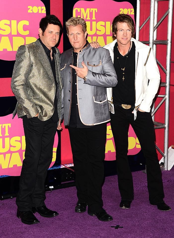 Rascal Flatts commanded all the attention on the red carpet in their eye-catching blazers-- well, at least two of them did. Jay DeMarcus went for silver glitter and Gary LeVox chose blue shimmer to dress up their black pants and shirts, while their bandmate Joe Don Rooney opted for a simple white jacket. Whose look do you like best?